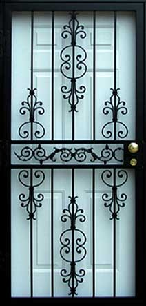 ornate black security door over white entry door