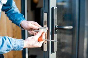 man installs a security door